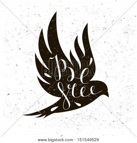 Black bird isolated with expanded wings on a light background with motivational quote Be free.