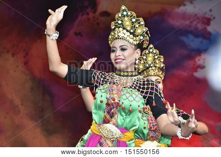 LONDON - SEPTEMBER 24: Malaysian cultural dancers performing the Mak Yong Dance at the Malaysia Fest 2016 in Trafalgar Square, London, UK, SEPTEMBER 24, 2016. The Festival is now in its 7th Year.