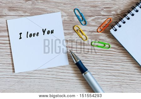 I LOVE YOU hand writting lettering on note at workplace or table.