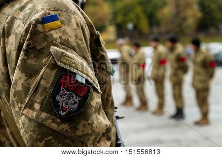 Uzhhorod Ukraine - October 12 2016: Soldiers of a guard of honor during a farewell ceremony on the funeral of a friend who died of his wounds in the ATO zone. The coffin with the body of the deceased Ukrainian heroic warrior honorably carried the city cen