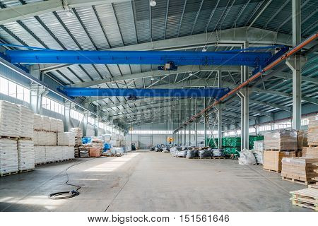 Interior of new large and modern warehouse space with nobody around