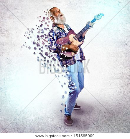 Elderly man playing guitar on light background. Creative music concept.