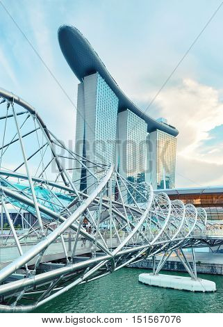 Singapore, Republic of Singapore - May 3, 2016: Helix spiral double bridge leading to Marina Bay Sands hotel