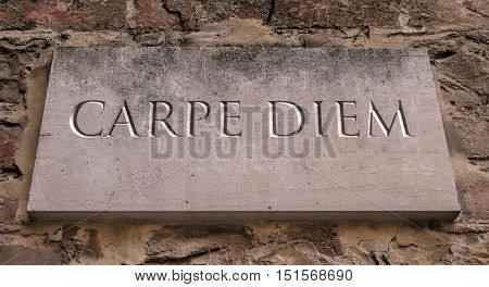 Carpe diem. A Latin phrase that means seize the day. By Horace. Engraved.