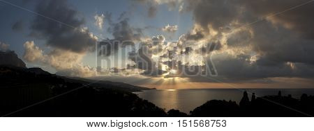 Large panorama dawn cloudy sky over the Black Sea.