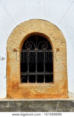 Forged Metal Lattice On Cellar Window