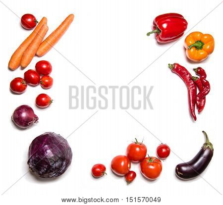 Red vegetables isolated on white top view. Vegetable frame or background. Copy space for text