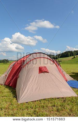 Tense tent in summer in quiet landscape