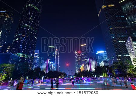 GUANGZHOU CHINA - OCTOBER 4:: Dusk view of the Flower Square and modern skyscrapers in Guangzhou downtown China on Octover 4 2016.