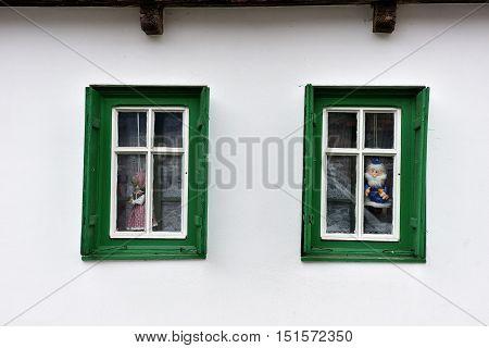 Dolls In The Window In A Village House