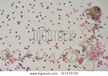 Abstract, romantic backround with space for text. Organic ribbon, pink and purple hearts