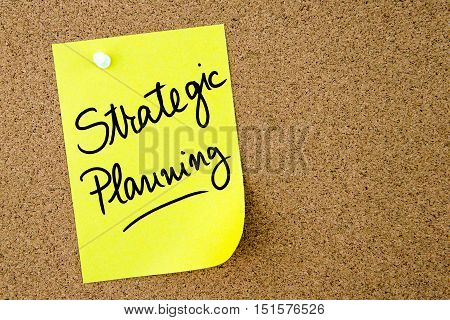 Strategic Planning Text Written On Yellow Paper Note