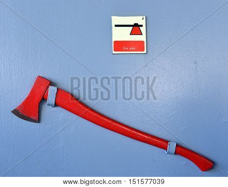 Firefighter axe on the cruiser boat wall