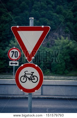 Bike and yield sign at a highway in Austria