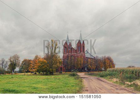 detached Catholic Church in Belarus in autumn.