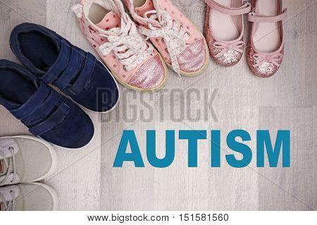 Children autism concept. Colorful kids shoes on floor