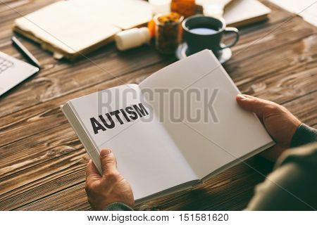 Children autism concept. Male doctor with book