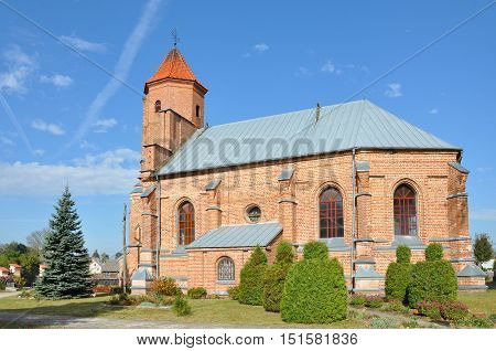 Old Catholic Church of red brick in the Gothic style in the village Gniezno, Grodno region, Belarus.