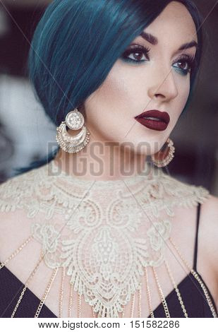 Woman with green hair looking good portrait photographed in studio