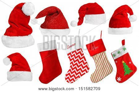 Santa Claus hats and Christmas stocking isolated on white