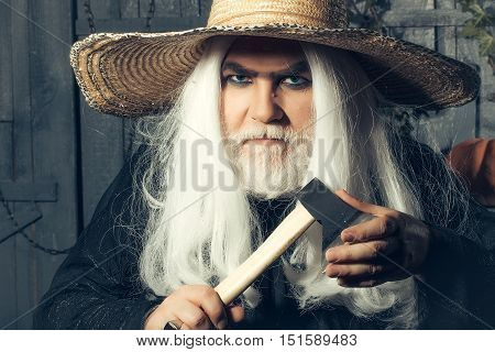 Man In Hat With Axe