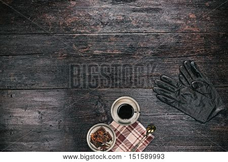 Autumn outfit of apparel with cup of coffee and spicy chocolate on dark wood surface. Flat lay