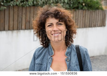 Lovely middle aged woman smiling at camera