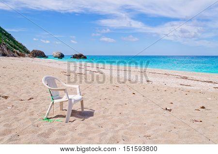 White chair on the beach Megali Petra on Ioian island Lefkada