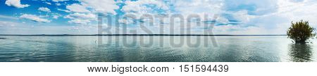 Panoramic view of the Kama river at summer sunny day. Panorama