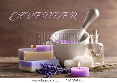 Spa composition on table. Word LAVENDER on blurred background.