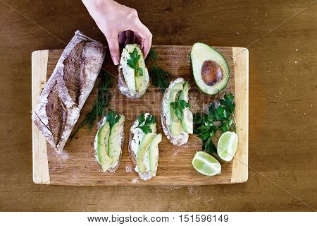 Avocado bruschetta organic fresh appetiser. Top view