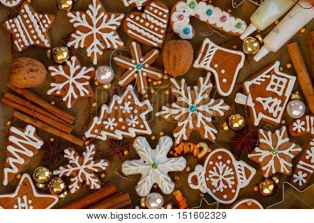 christmas gingerbread cookies with christmas decorations on wood - christmas food background