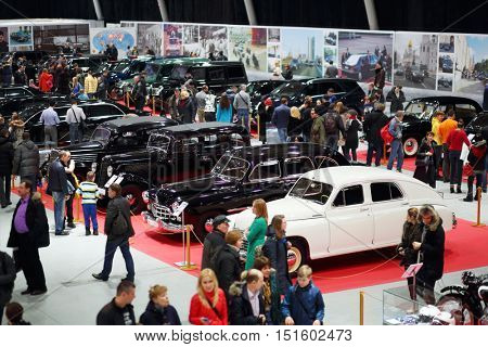 MOSCOW - MAR 07, 2016: People walk in Exhibition Oldtimer-Gallery in Sokolniki Exhibition Center. It is only one in Russia exhibition of vintage cars and technical antiques