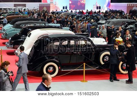 MOSCOW - MAR 07, 2016: Crowd and cars on exhibition Oldtimer-Gallery in Sokolniki Exhibition Center. It is only one in Russia exhibition of vintage cars and technical antiques