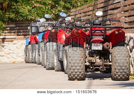 Atv Quad Bikes Stand Parked In A Row