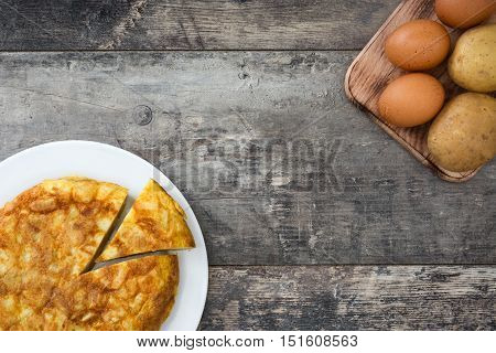 Traditional spanish omelette on wooden table background