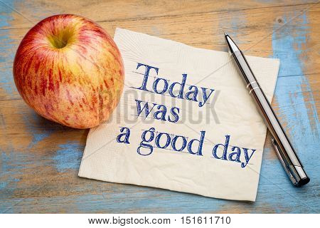Today was a good day positive affirmation - handwriting on a napkin with a fresh apple