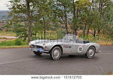 MELDOLA, FC, ITALY - SEPTEMBER 18: driver and co-driver on a German vintage car BMW 507 roadster (1956) in classic car rally