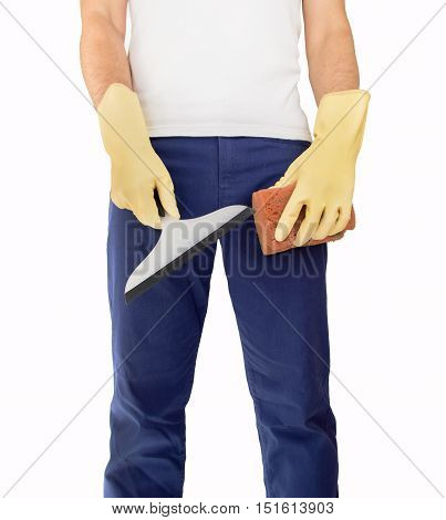 cleaner standing and holding squeegee and sponge to make the work
