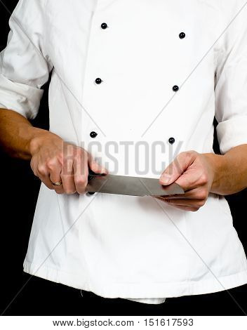 Professional Chef Holding A Sharp Cooking Knife In Hands Wearing A Chefs Jacket