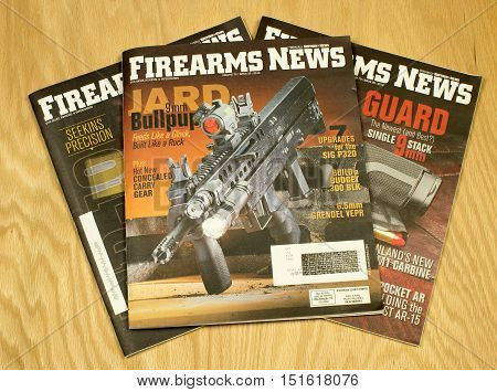 RIVER FALLS,WISCONSIN-OCTOBER 13,2016: Several copies of the Firearms News monthly magazine.