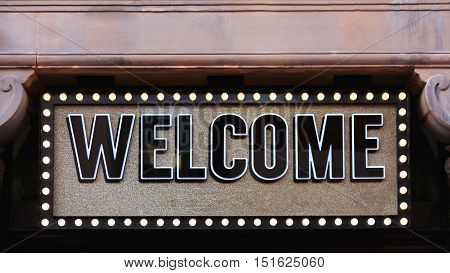 Welcome Sign at Gold Background With Lights