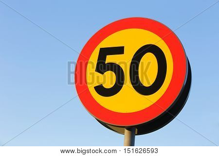 Swedish road sign indicating the speed limit 50 km / h