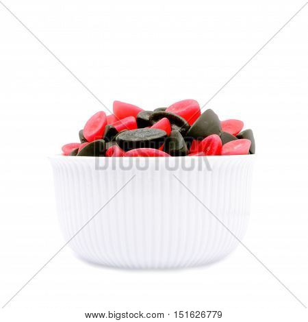 A bowl of licorice and raspberry boats.