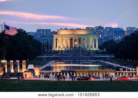 Sunset at the National Mall in Washington D.C. with a view of the Lincoln Memorial and the Reflecting Pool