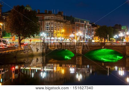 Embankment of Liffey River in Dublin Ireland. Night view with buildings and city lights at the background