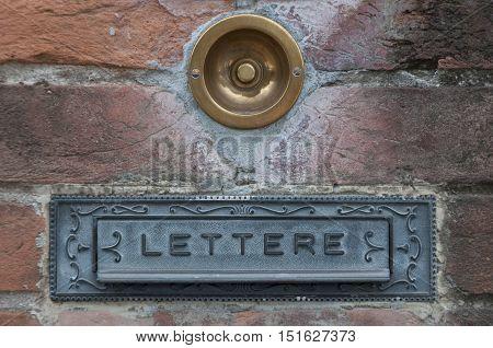 vintage mailbox and doorbell in Italy, Brescia