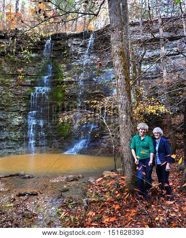 Mother and daughter hike to Twin Falls also known as Triple Falls in Northern Arkansas. Falls are located in the Buffalo River National Wilderness Area.