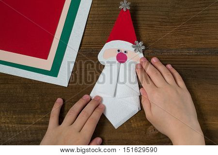Creating a Christmas decoration for table setting. Decor for serviette in form of Santa Claus. Children project step by step photo instructions. Step 8. Final design for serviette