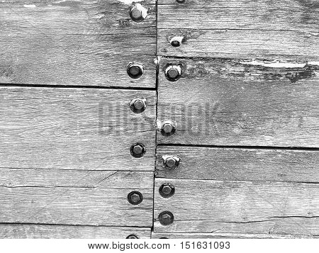 Closeup of the wood and screws in personal docks in black and white